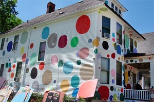 Exterior Painting Techniques - ProTek Painters - Newton, MA - White two story house with multicolored polka dots