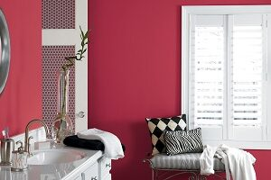 Dark pinkish red with black and white accents