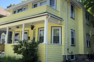 AFTER - Exterior Painting - Newton MA - Yellow with White Trim - ProTEK Painters