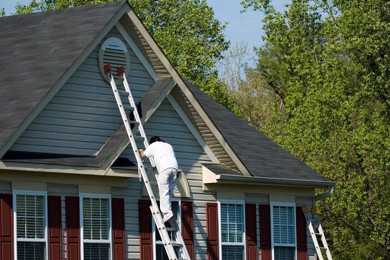 Exterior Painting - Newton, MA - Painter Climbing Ladder - ProTEK Painters