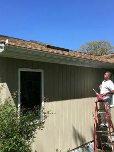 House Painter - ProTEK Painters - Needham, MA - Exterior painter on ladder with paintbrush