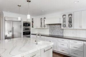 Gorgeous White Kitchen Cabinets Gray Backsplash Black Countertops - ProTEK Painters