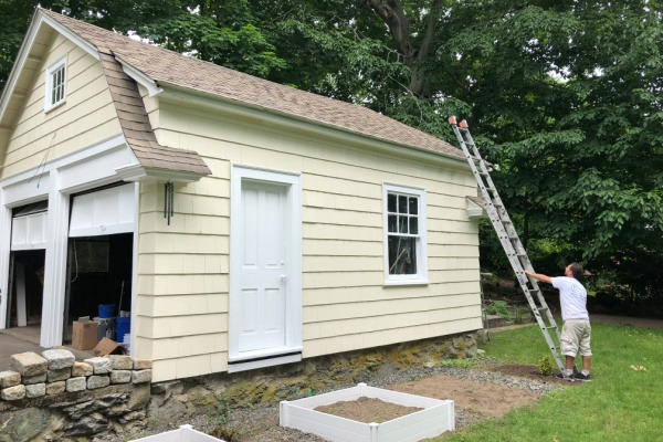 1 AFTER – Exterior Painting – Newton MA – Yellow Garage White Door – ProTEK Painters 600X400