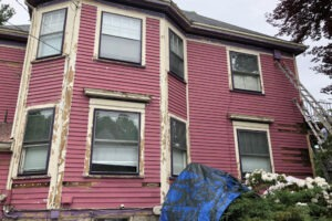 BEFORE - Exterior Painting of Pink Two-Story in Newton MA - ProTEK Painters 1024