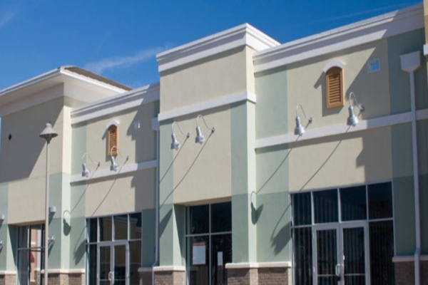Commercial Painters - Tan and Green Stucco White Trim - Newton MA 600x400