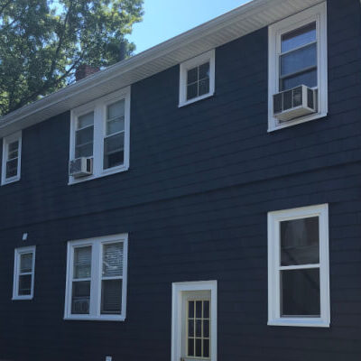 After repaint of cedar shingle siding home in Newton, MA - Black with white trim