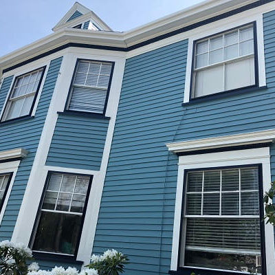 After exterior painting - Newton, MA - Blue siding with white trim