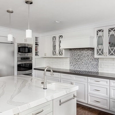 Gorgeous White Kitchen Cabinets Gray Backsplash Black Countertops - ProTEK Painters 600x400 Comp