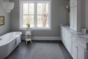 Bathroom Painting-Gray walls and marble counters are accented with a checkered rug-Interior Painting-ProTEK Painters